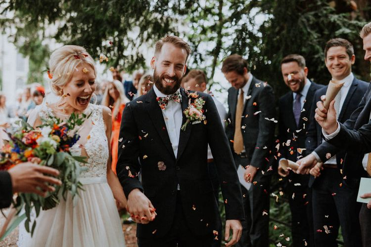 Groom Bow Tie Confetti Moment Image by Meghan Lorna Photography
