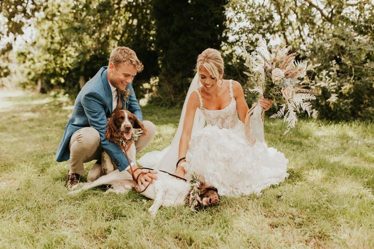 Bride and groom with pet spaniels at wedding for 15 people