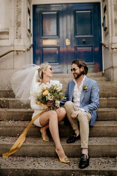Cool intimate London wedding with bride in short wedding dress at wedding for 15 people