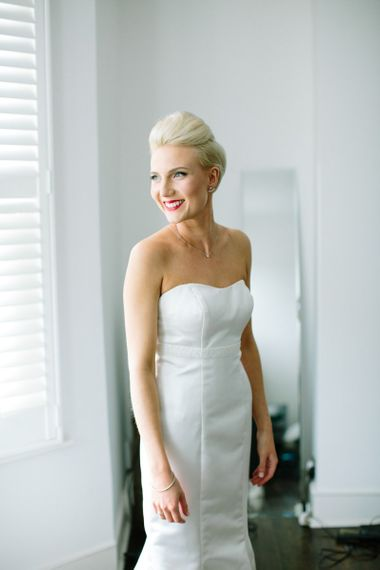 Bride in strapless wedding dress with pinned fringe