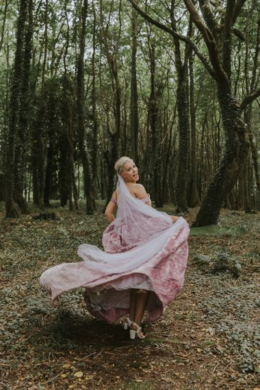 Bride with short hair in pink wedding dress and long with long veil