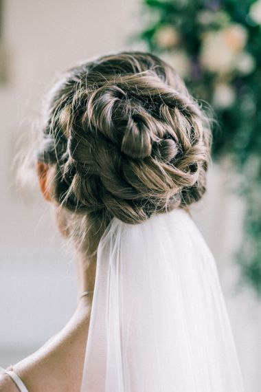Braided bridal up do with wedding veil