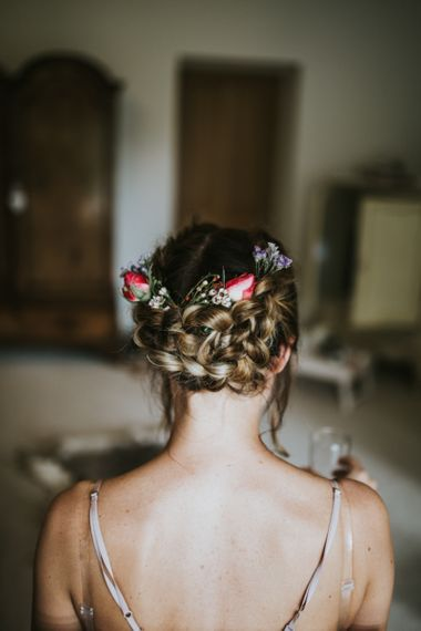 Bridal pinned plaits with fresh flowers