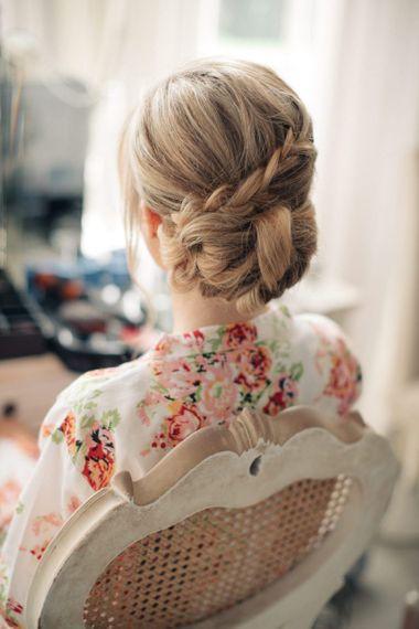 Elegant braided wedding hair pinned into a bun
