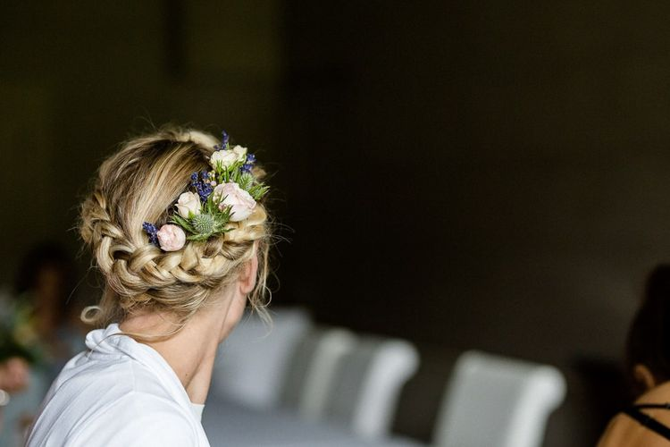 Bride with plaited updo and fresh flowers