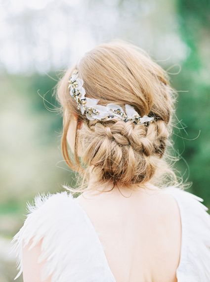 Low chignon with braid and wedding hair accessory