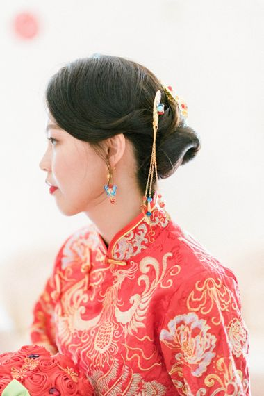 Asian bride with sleek wedding bun and traditional Chinese accessory