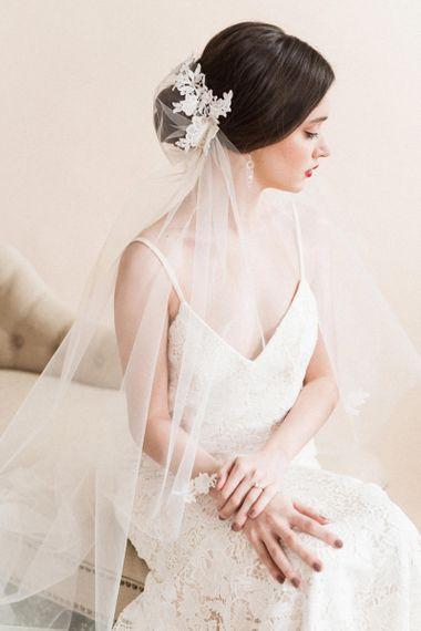 Sleek side bun with wedding veil
