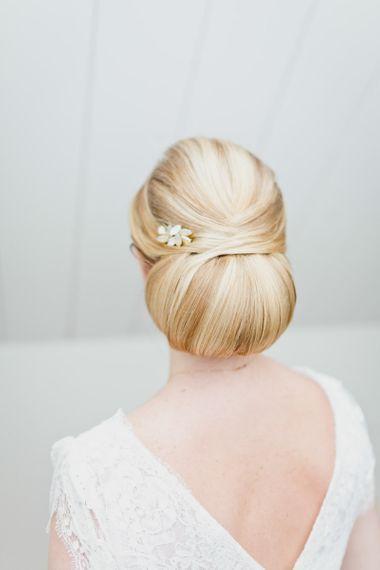 Sleek oversized bun with hair pin