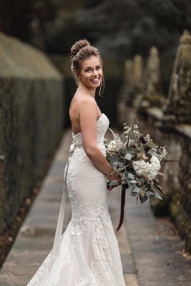 Bride in strapless dress with top knot