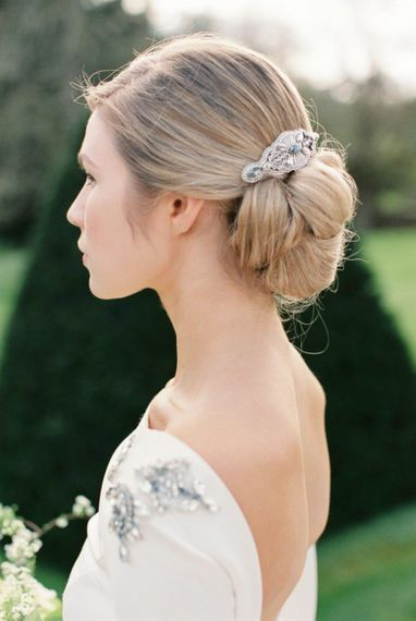 Low pinned bun with hair accessory