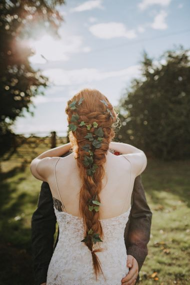 Bride with long braided plait with foliage