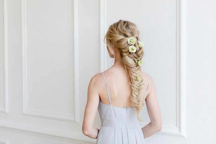 Long fishtail braid with fresh flowers