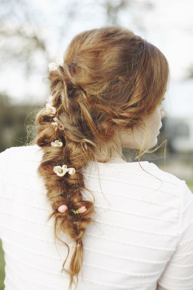 Bridal plait with flowers intertwined