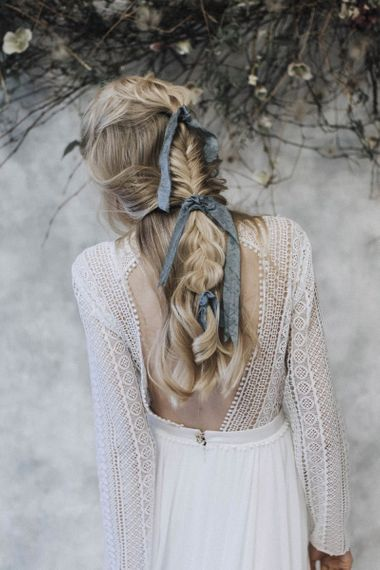 Fishtail braid tied with blue ribbon