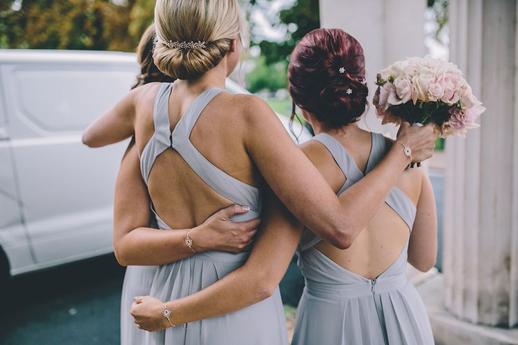 Bridesmaid in grey dresses with different hairstyles