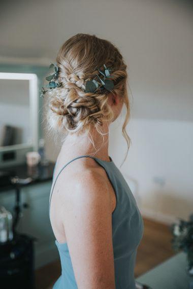 Pinned bridesmaid hair with eucalyptus foliage