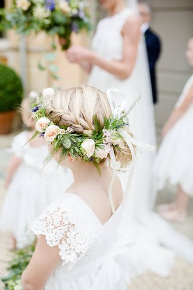 Flower girl with braided hair and flower crown