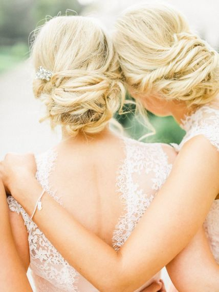 Pinned bridesmaid hair in low buns