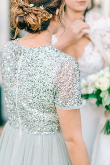 Light green sequin bridesmaid dress with pinned up do