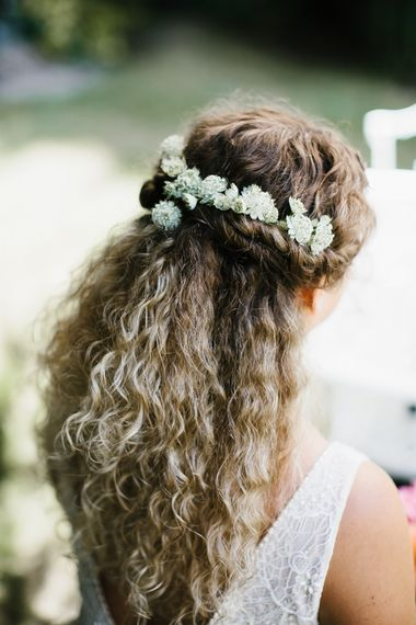 Half up half down curly hair wedding hair with flowers