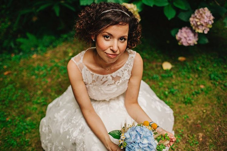 Bride in Rosa Clara wedding dress with curly hair