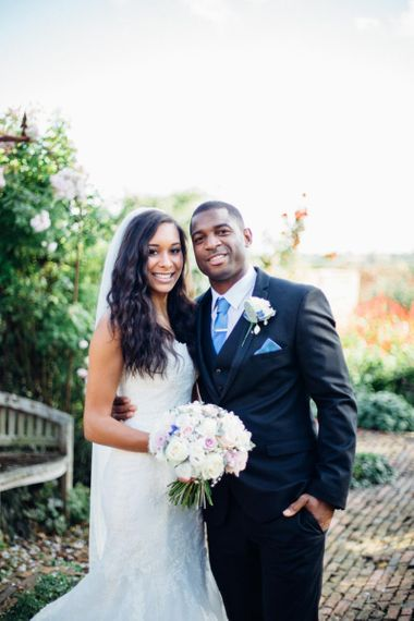Black bride and groom at pastel country farm wedding