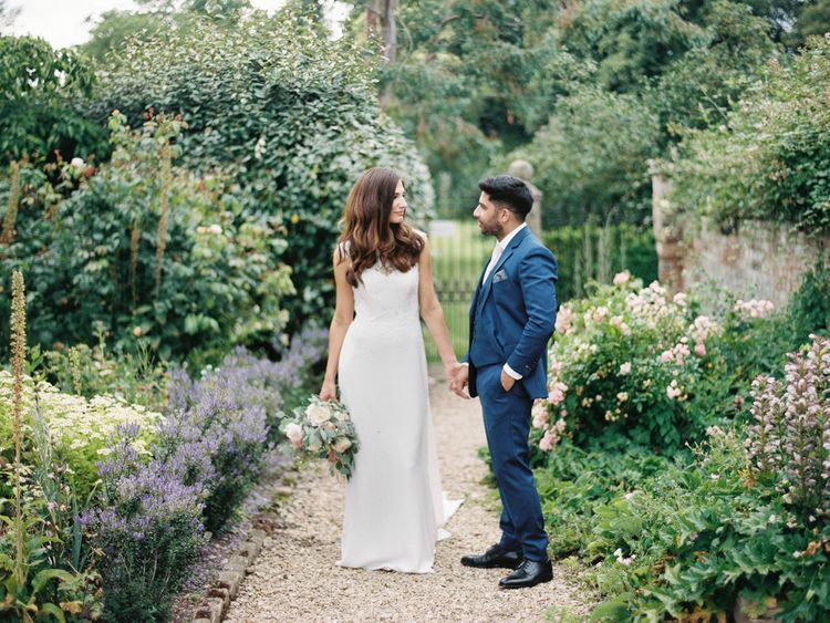 Bride and groom portrait in Elmore Courts gardens
