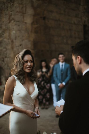 Stunning bride saying her vows at Italian wedding ceremony