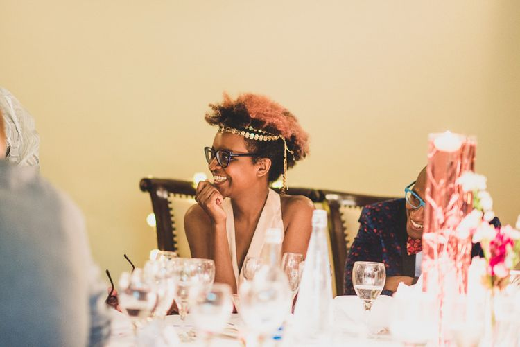 Black bride with glasses and gold wedding hair accessory
