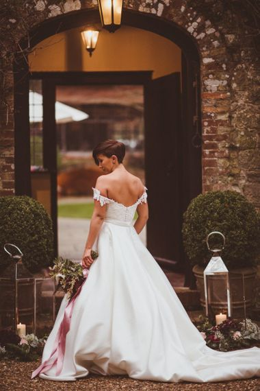 Bride with short hair in Bride in Lillian West bridal separates