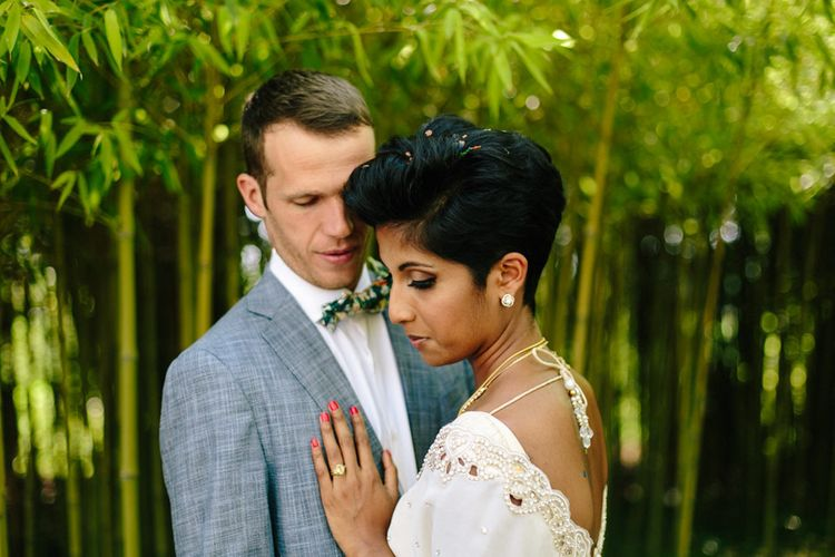 Bride in gold sari with short hair