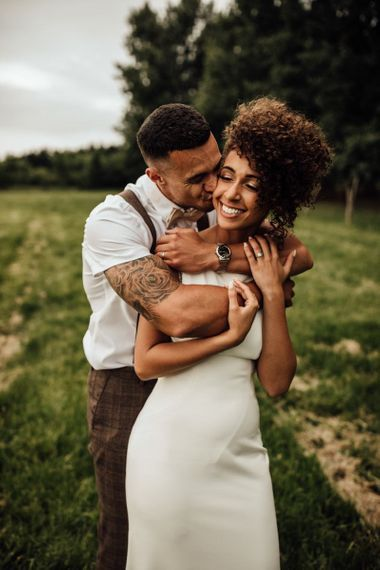 Black bride in Maggie Sottero wedding dress with short afro hair
