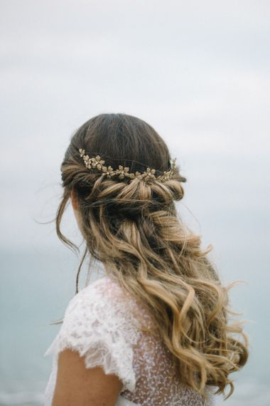 Half up half down wedding hair with rolled pinned detail