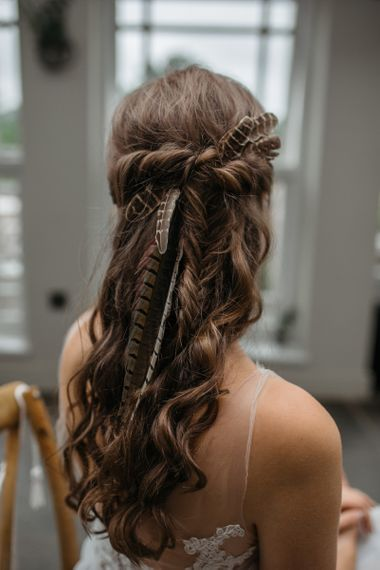 Half up half down wedding hair with feathers