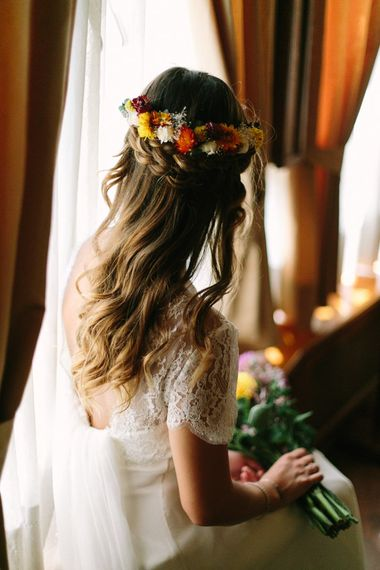 Braided half up half down wedding hair with flowers