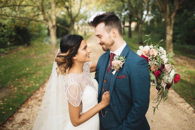 Bride in Catherine Deane wedding dress an Groom in wool suit