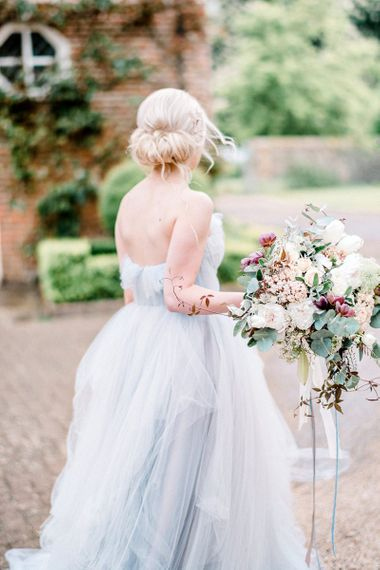 blue wedding dress and pinned chignon