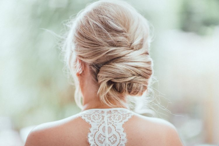 Bride in Racer back dress with pinned bridal hair
