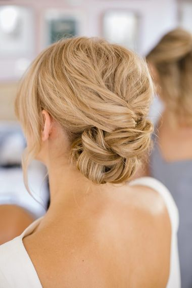 Woven and pinned wedding hairstyle