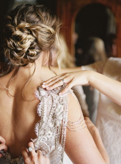 Romantic loosely pinned bridal updo