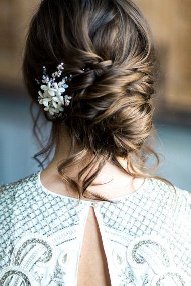 Pinned wedding hair with bridal accessory