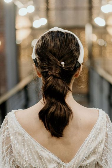 Bridal ponytail with headband and pin detail