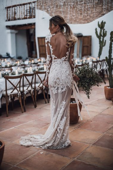 Bride in lace wedding dress with ponytail