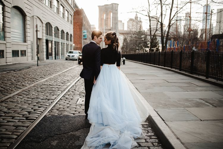 Bride in blue tulle skirt and wool jumper with ponytail