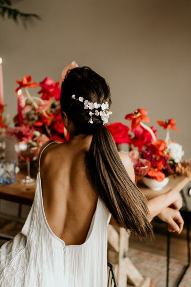 Sleek ponytail with hair accessory