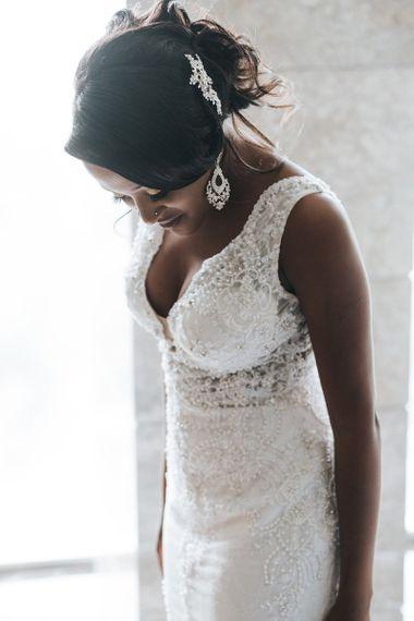 Black bride in lace wedding dress with chandelier earrings
