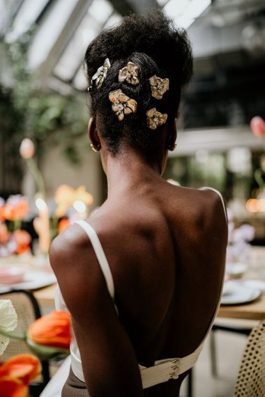 Black bride with Tilly Thomas Lux hair pieces pinned in her hair