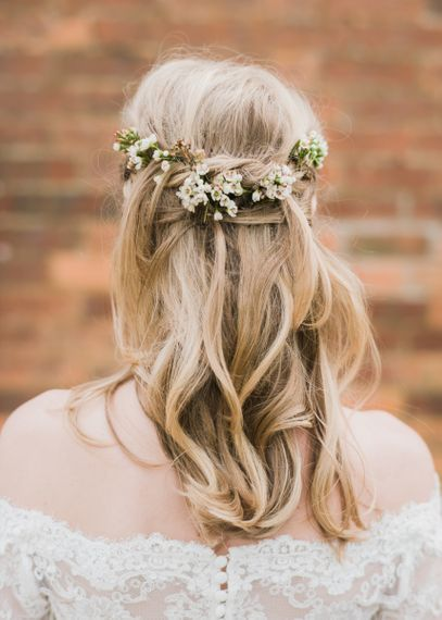 Half up half down hair with fresh flower stems