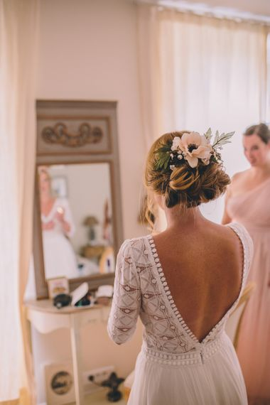 Wedding morning bridal preparations with bride wearing flowers in her hair